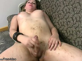 Chubby Tgirl in red thongs exposes big boobs and tranny cock