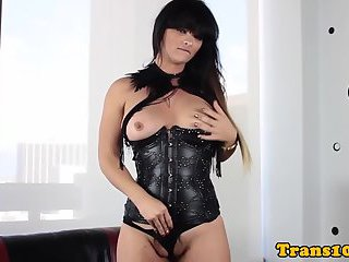 Kinky shemale in corset wanking off