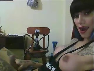 Big tits tattooed shemale teen having fun