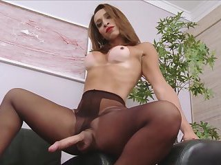 Shemale tranny plays with her 10 inch cock