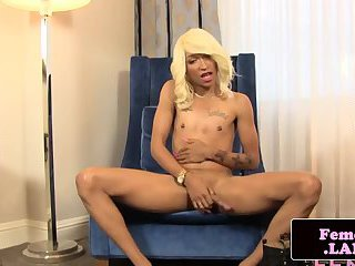 Ebony femboy rubs her cock on chair