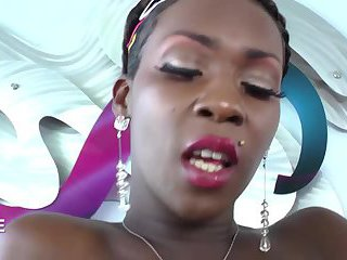 Pretty ebony TS plays with her cock