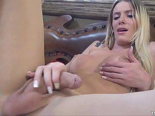 Taissi yanks her big cock.