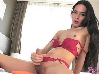 Lovely asian ladyboy masturbates cock