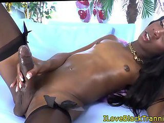 Smalltitted ebony shemale pleasuring herself