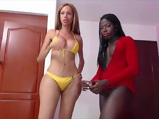 Hot blonde ts sucks a huge ebony shecock