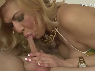 Blonde Milf shemale makes blowjob to the old man