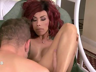 Horny guy sedues a sexy redhead shemale