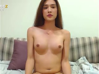 Cute asian shemale masturbates hard
