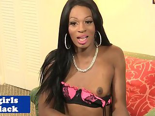 Attractive nubian tranny sensually strips