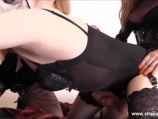 Lucky crossdresser slut is fucked and sucked by two horny strapons before cumming