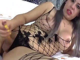 Busty TGirl in Fishnet WankCum