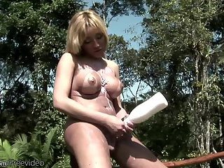 Horny shebabe stuffs her shecock in milk bottle and cumshots
