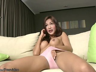Girly ladyboy with pretty smile plays with her round boobs