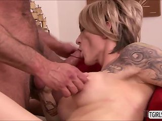 Blonde tranny Nina Lawless gets big tits sucked by a horny dude