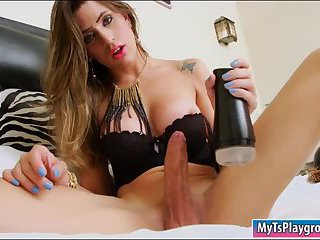 Busty tgirl fucks her cock with a sex toy