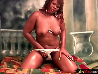 Oiled up ebony shemale spreads and shakes massive black ass