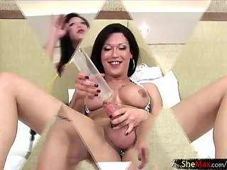 Slutty brunette shemale pumps up her boner and squirts jizz