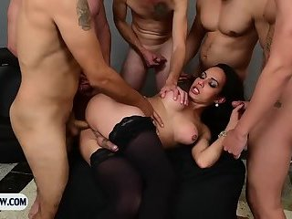 Delicious tranny from Brazil gangbanged by a bunch of guys