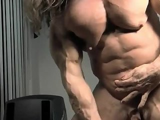 Muscle hermaphrodite jacks off her tiny dick