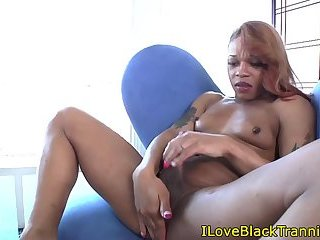 Alluring tranny tugging on her black cock