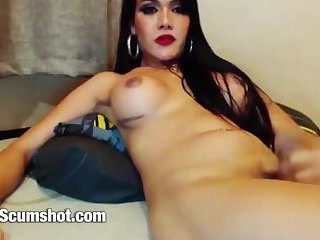 Beautiful asian ladyboy wanking her mushroom dick and cums on Cam