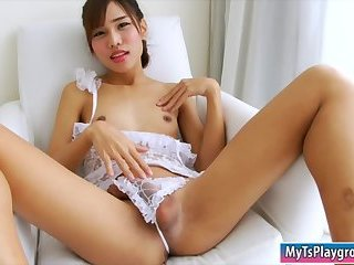 Teen ladyboy Noey strokes her hard cock