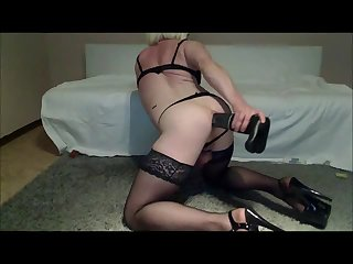 Crossdresser slut Sandy fucks a huge toy fist and cum
