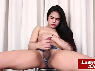 Petite asian tranny plays with her big cock
