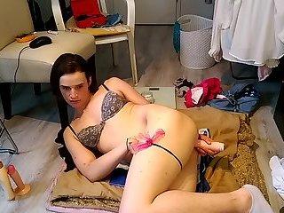 Tranny stuffs her ass with a dildo