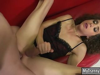 Curly haired TS Lily Demure anal rammed