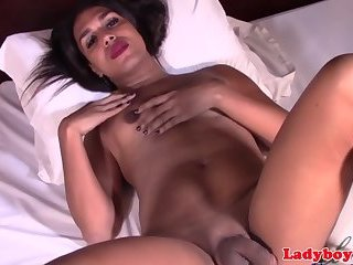 Busty masturbating piladyboy spills cum