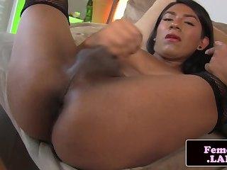 Ebony femboy masturbating in solo action