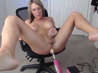 Cute tgirl on a fuckmachine