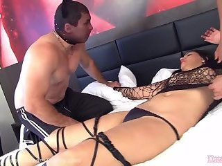 Transsexual Sara Oliveira Yields Her Mouth and Ass to Two Thugs