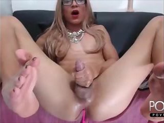 Blonde tranny jerking big dick on cam