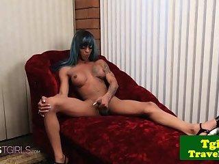 Masturbating ebony ts strokes her cock