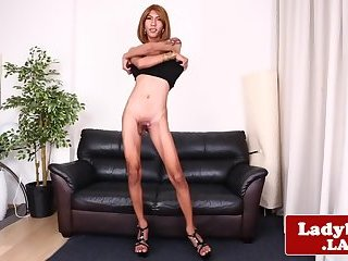 Inked ladyboy wanking and stroking herself