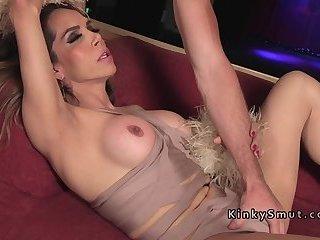 Huge tits brunette tranny gets blowjob