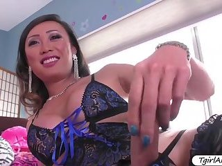 Tanned Ts Venus Lux bangs Marilyn Moores tight pussy in doggystyle