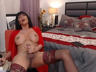 Beautiful ladyboy in red drops creamy load
