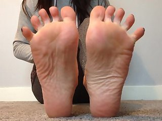 Feet tease with soles and painted toes.