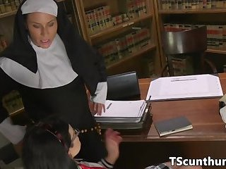 TS babe assfucking a busty nun on all fours