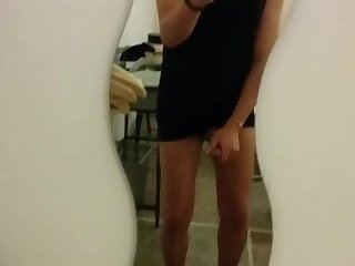Teen beauty crossdresser in black dress with a big load