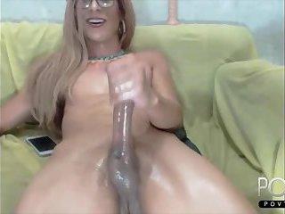 Mature blonde jerking big cock on cam