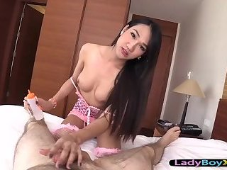 Cute asian ladyboy gives a slow handjob POV style