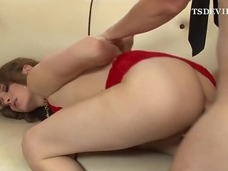 Young Tgirl fucked on the sofa