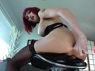 Redhead shemale streches her holes with big dildos