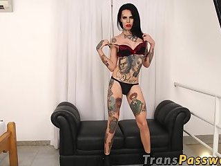 Tattooed tranny Gaby Ink tugging her big swollen cock