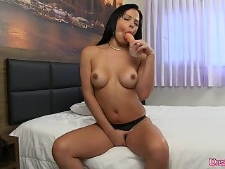 Shemale Bruna Castro beating off with a dildo